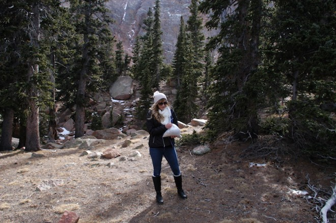 Sarah Plank on Pikes Peak, preparing to scatter the remains of Chief Wana Dubie to the wind. - JESSICA MACHETTA/COLORADOPOLITICS.COM