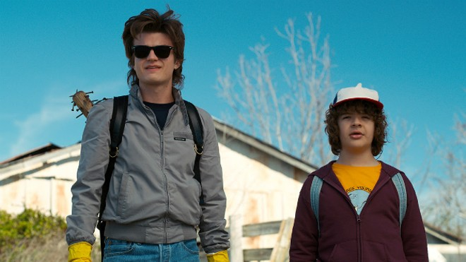That shirt worn by 'Stranger Things' character Dustin (right) was designed by a Missouri orthodontist. - IMAGE VIA NETFLIX