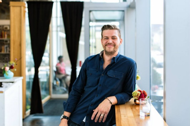 Kelly Nyikes creates community behind Sardella's bar. - SPENCER PERNIKOFF