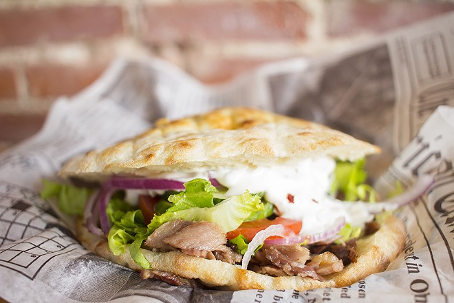 The doner kebab comes with lettuce, cucumbers, tomatoes, red onions and tzatziki on housemade somun bread. - MABEL SUEN