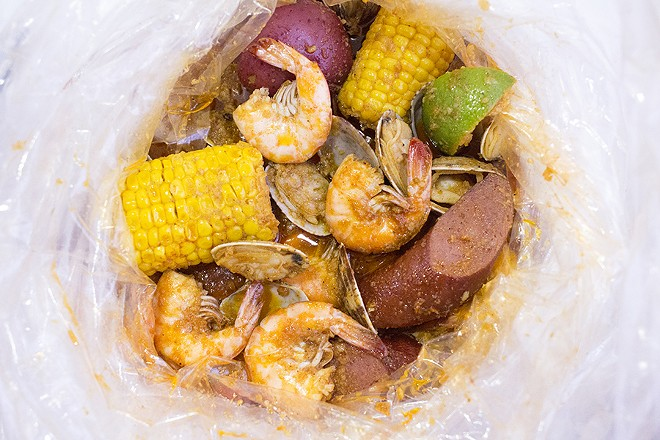 "Combos come with your choice of seasoning -- lemon pepper. Ragin' Cajun or garlic -- or the ""Whole Shabang,"" which includes all three. - MABEL SUEN"
