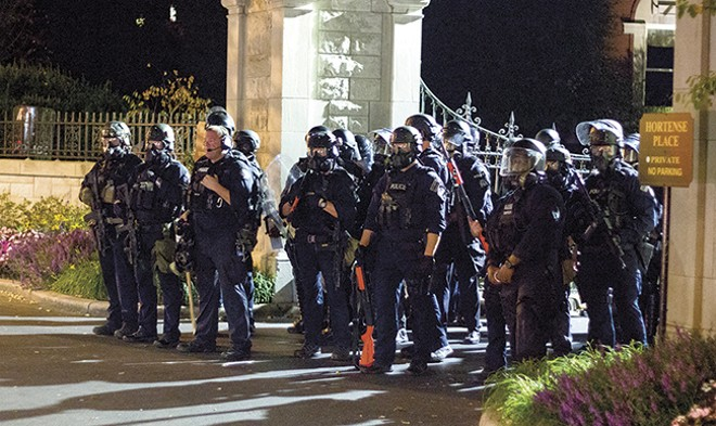 Sgt. Brian Rossomanno (center, no helmet) stands with riot police on Sept. 15 at the edge of Euclid Avenue. - PHOTO BY DANNY WICENTOWSKI