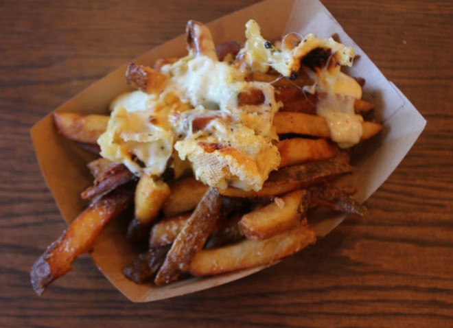 Housemade fries are topped with raclette cheese. - CHERYL BAEHR