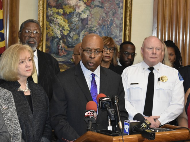 Public Safety Director Jimmie Edwards (center) announces a gun buyback in St. Louis. - PHOTO BY DOYLE MURPHY