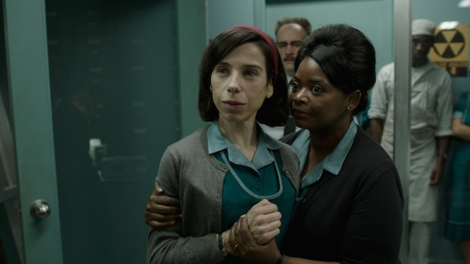 Elisa and Zelda (Sally Hawkins, Octavia Spencer) are janitors and friends in the 1960s. - ​COURTESY OF FOX SEARCHLIGHT PICTURES; © 2017 ​TWENTIETH CENTURY FOX FILM CORPORATION