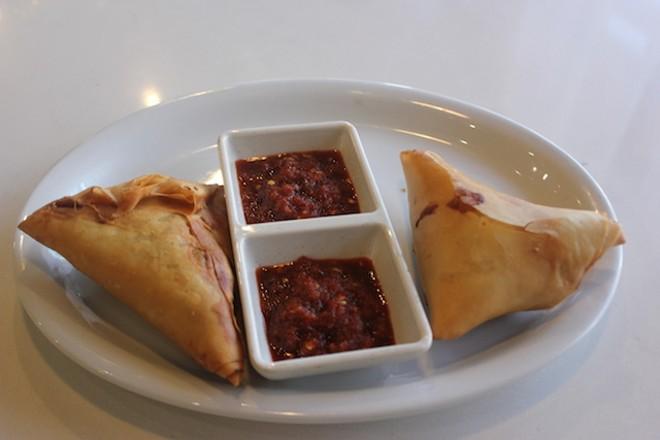 Lentil sambusas come with chile sauce on the side. - SARAH FENSKE