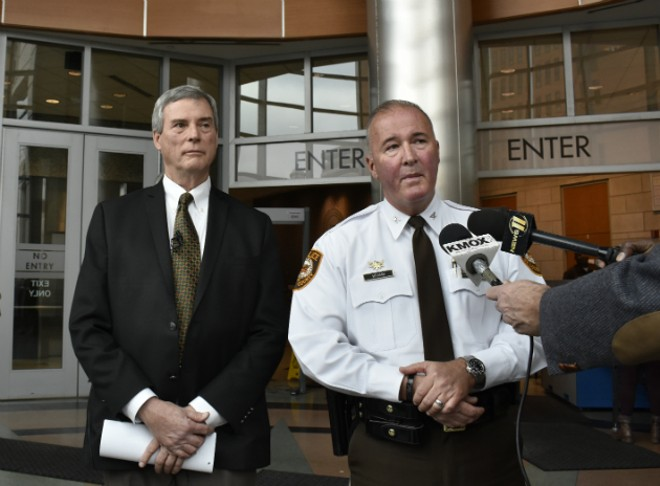 St. Louis Country Prosecuting Attorney Robert McCulloch and county police Chief Jon Belmar discuss the case. - PHOTO BY DOYLE MURPHY