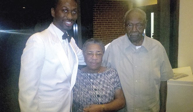 Duncan, with foster parents Alice and Willie Duncan, celebrates his Jefferson College performance. - COURTESY OF MALACHI DUNCAN