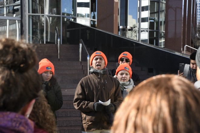 Rigo, center, and other Dreamers in orange hats lead a demonstration in front of Sen. Roy Blunt's office. - DOYLE MURPHY