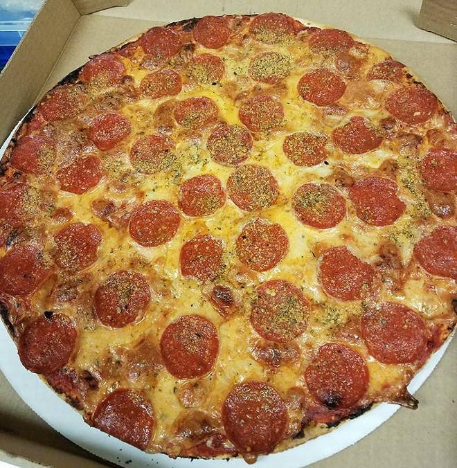 The St. Louis-style pepperoni pizza generously employs Provel. - COURTESY OF JAKE'S PIZZA
