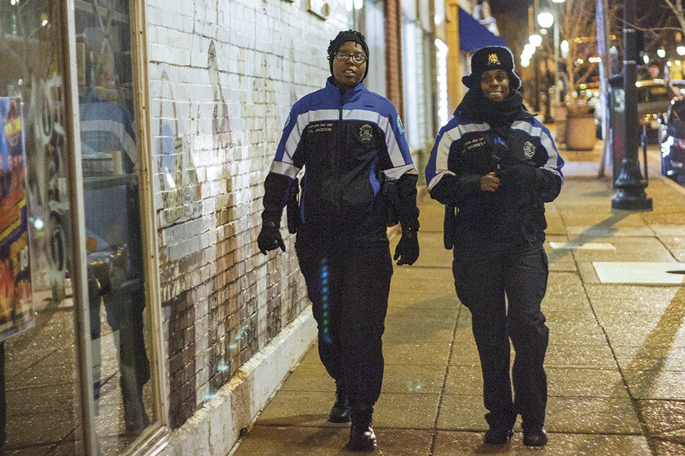 On duty on a cold night, officers Devin Guajardo (left) and Jazmon Garrett serve as the SLMPD's anchors on Cherokee Street.