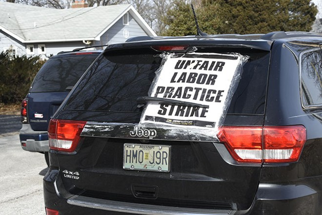"""A car parked outside of Christian Care home with a sign that reads, """"unfair labor practice strike"""". - MEGAN ANTHONY"""