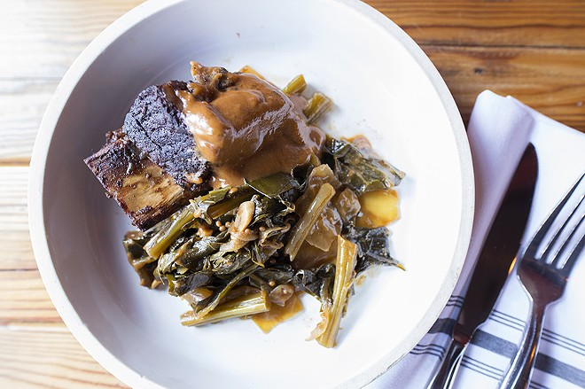The short rib comes with house steak sauce, braised greens and black-eye peas. - MABEL SUEN