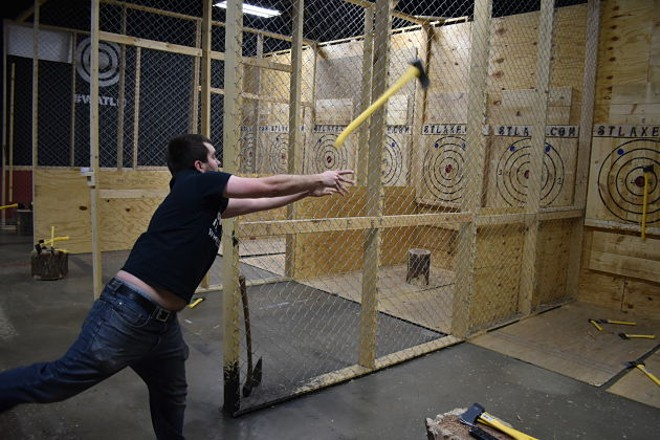 Aaron Cockrell, STL Axe Throwing's owner, shows how it's done. - PHOTO BY DANIEL HILL