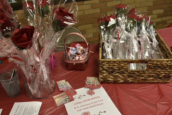 Flowers and candy add a romantic touch to the Ash Wednesday fish fry at St. Francis of Assisi. - ALLISON BABKA
