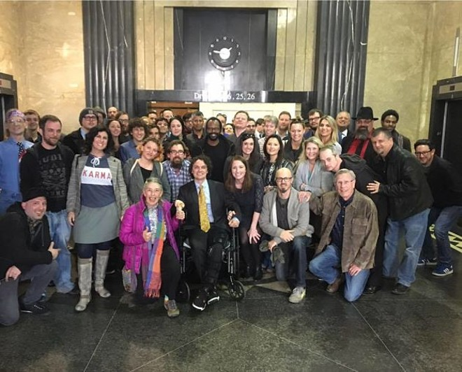 David Grelle, center, has fought his way back after a horrific hit and run. Friends and family have routinely packed the courthouse on his behalf. - COURTESY OF THE GRELLE FAMILY