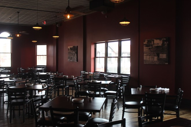 The second floor has a high ceiling and large windows overlooking the street — the antithesis of the upstairs room at many restaurants. - SARAH FENSKE