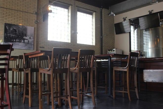The first-floor area offers communal tables or high tops. - SARAH FENSKE
