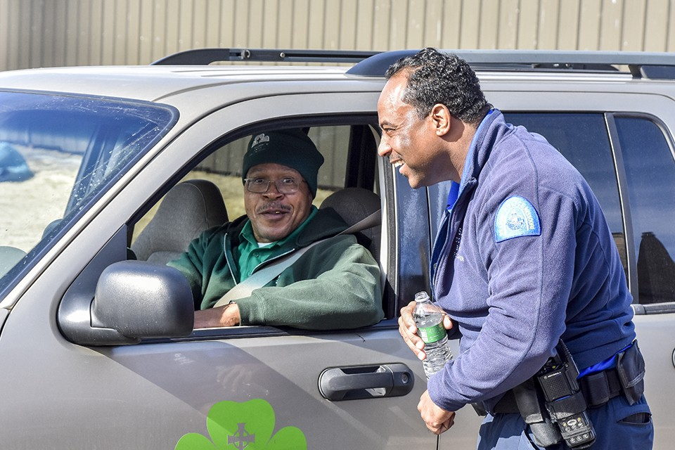 Outreach worker Alvin Ferguson of St. Patrick Center and St. Louis police Officer Larry Dampier work with the homeless every day. - DOYLE MURPHY