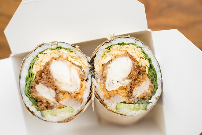 "The ""Tasty As Cluck"" roll includes fried chicken, kimchi slaw, arugula, pickles, crispy shallots, tempura crunch and ""OG Fire"" sauce. - MABEL SUEN"