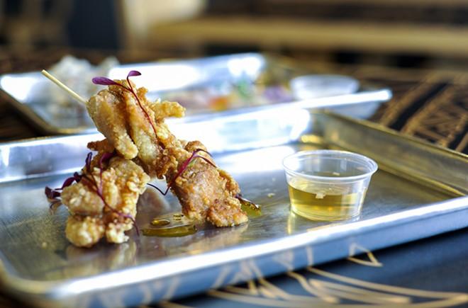 """""""Chicken Skin Skewers"""" are among nine """"Merienda,"""" or smaller bites, on the menu. - KELLY GLUECK"""