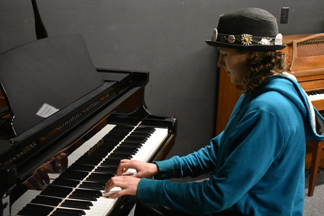 Piano's for People student Hadassah Stone tickles the new ivories. - DANIEL HILL