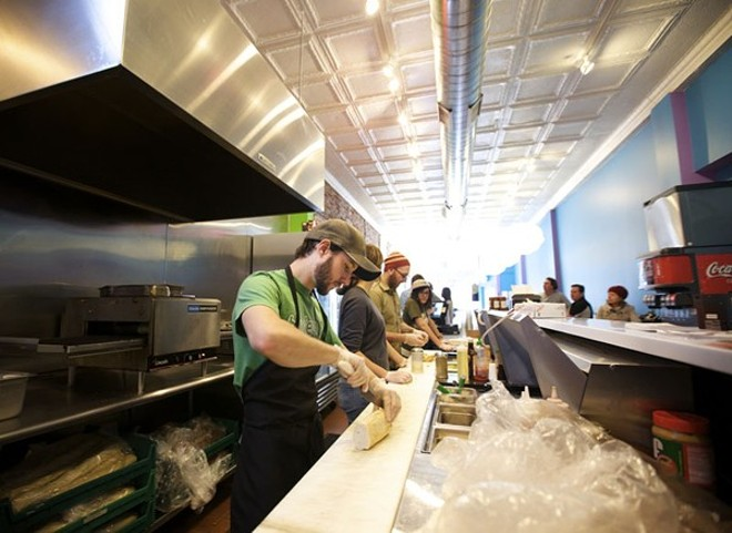 Staffers make sandwiches at Snarf's original St. Louis location on Delmar. - JENNIFER SILVERBERG
