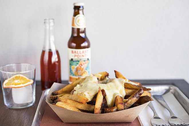 The raclette cheese fries are a sight to behold ... and even better to eat. - MABEL SUEN