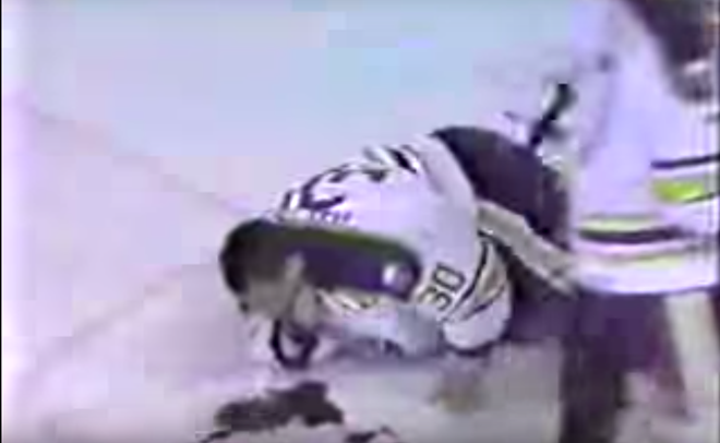 A wounded Clint Malarchuk gushes blood on the ice. - SCREENSHOT