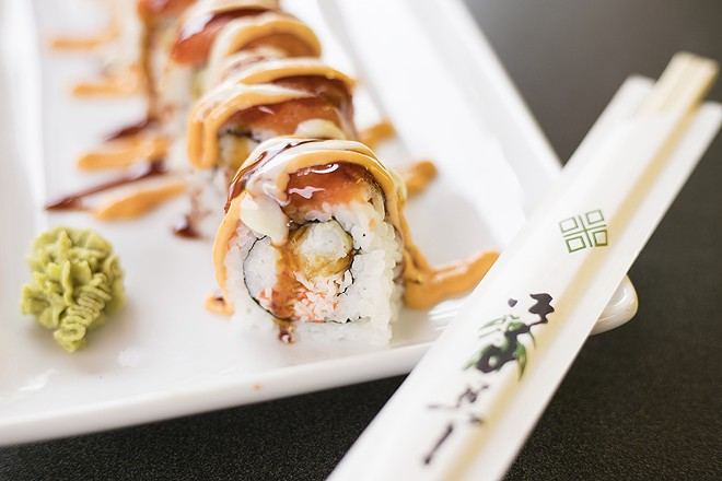 """The """"Cardinal"""" roll is stuffed with crab salad, tempura shrimp and cream cheese. - MABEL SUEN"""