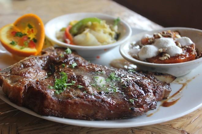 Steak comes with soul food sides. - SARAH FENSKE