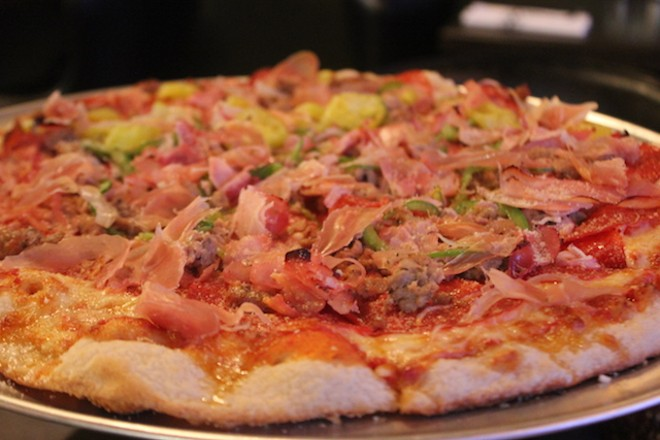 """""""El Padrino"""" is chock-full of ham, salsiccia, prosciutto, peppers, red onion and roasted garlic. - SARAH FENSKE"""