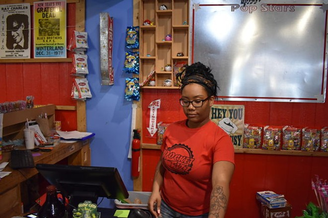 Jessica Bolton manning the register. - DANIEL HILL