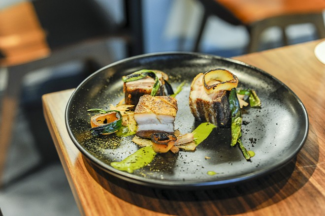 Crispy pork belly with ramp puree. - KELLY GLUECK