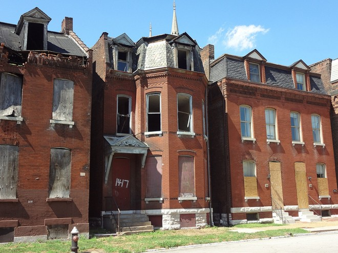 Vacant homes in the city's Hyde Park neighborhood. - FLICKR/PAUL SABLEMAN