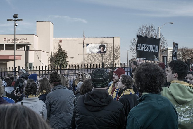 Anti-abortion protesters gather at Planned Parenthood in CWE in 2016. - PHOTO VIA PAUL SABLEMAN/FLICKR