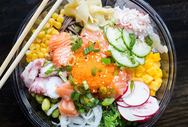 Soba noodles prove an alternative to rice. They're shown here topped with salmon, octopus, corn, ginger, mango, seaweed salad, onion, edamame and crab meat. - MABEL SUEN