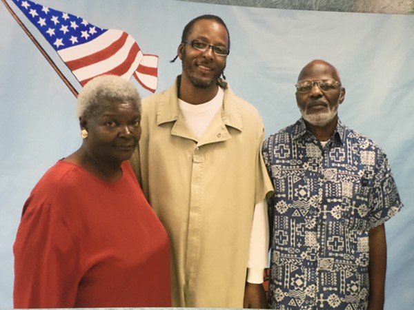 Christopher Dunn, shown here with this mother and uncle. - COURTESY OF KIRA CAYWOOD