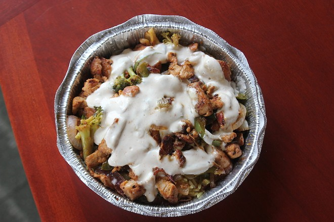 """A chicken kebab lunch special with rice, vegetables and """"white sauce."""" - SARAH FENSKE"""