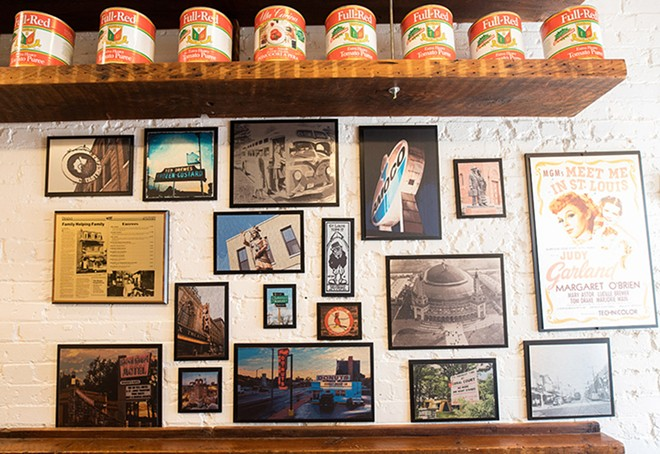 The storefront features St. Louis memorabilia. - MABEL SUEN