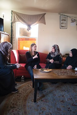 Jessica Bueler, center left, works with Alifa Alahmed, Iman Alkrad and Najlaa Alsaadi to plan an upcoming Supper Club event. - SARA BANNOURA