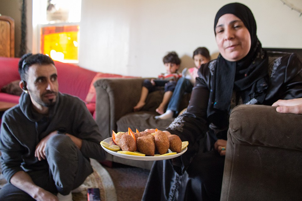 Iman Alkrad is the matriarch of one of a handful of Syrian refugee families still living in a run-down apartment complex in north St. Louis.