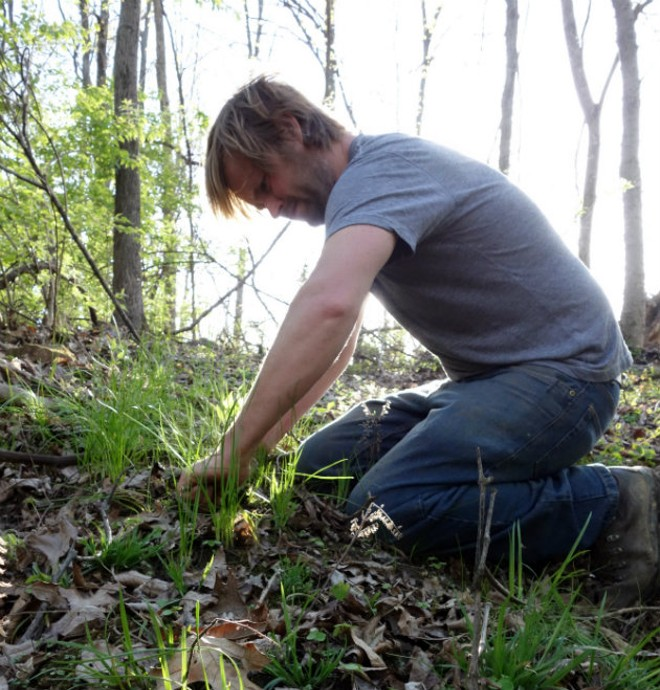 Aaron Kleidon scouring the land for ingredients. - COURTESY OF SCRATCH BREWING COMPANY