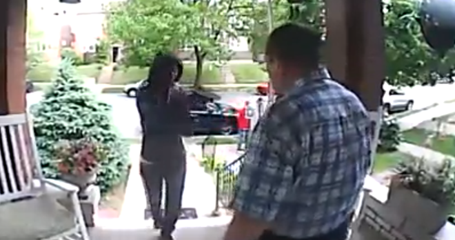 A Tower Grove East man stares down an armed robber in this screen grab from a security video posted by KSDK. - KSDK