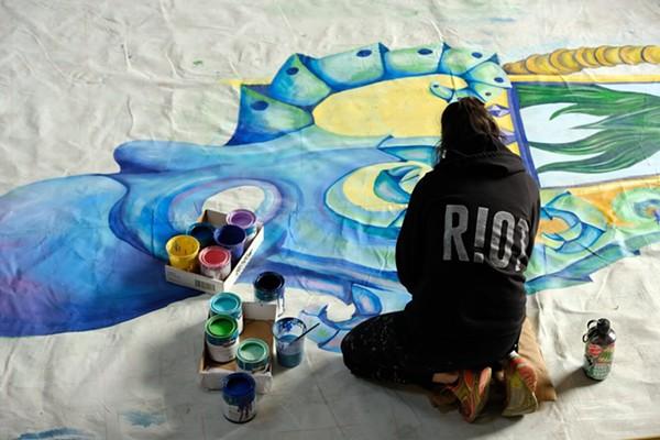 Chalk Riot artists at work. - CHANDLER BRANCH