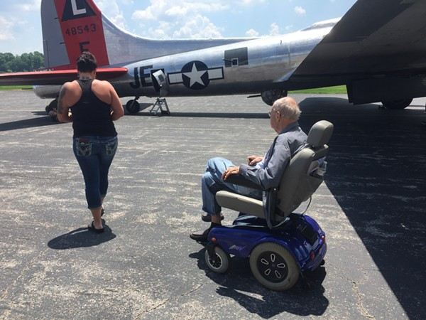 General Ron Youngs and his granddaughter Alison Youngs board the B-17. - PHOTO BY JAIME LEES