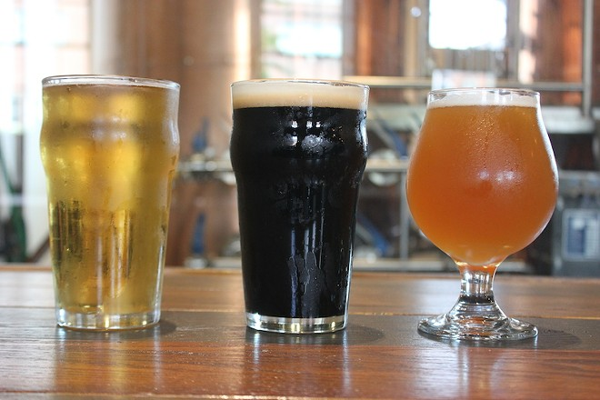Three of Twisted Roots' current roster of offerings: The Canookie, a lite American lager; the Irish Flu, an Irish extra stout; and Kali, a mango-saturated pale ale. - SARAH FENSKE