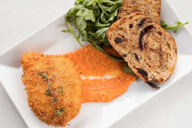 Burrata is breaded and fried and served over romesco sauce. - MABEL SUEN