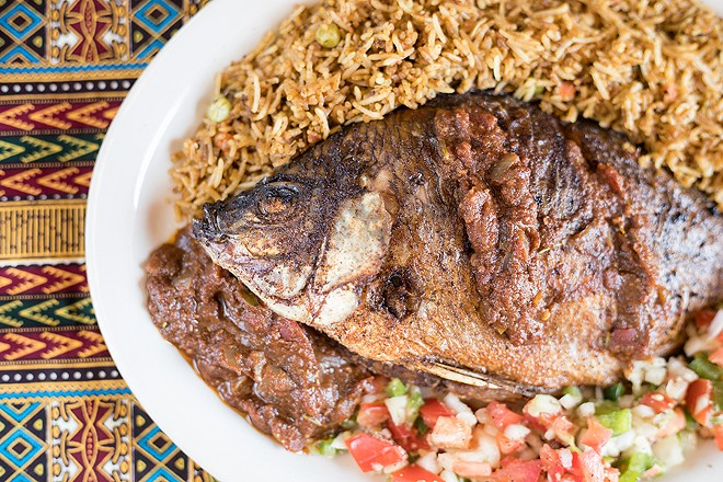 Whole tilapia is marinated in herbs and spices, then deep fried. - MABEL SUEN