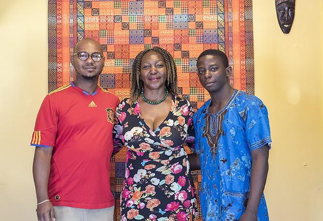Chef Christine Mukulu Sseremba and her sons George Knudsen and Majesty Mukulu. - MABEL SUEN